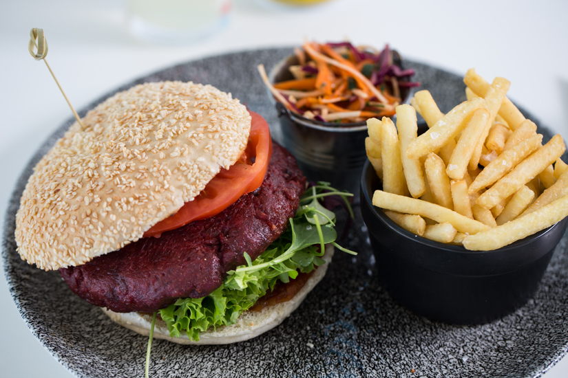 Smoky beetroot and black bean burger with cherry tomato relish